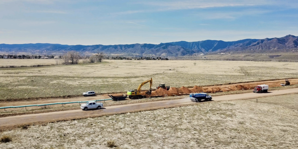 A drone photograph of construction equipment working on a pipeline